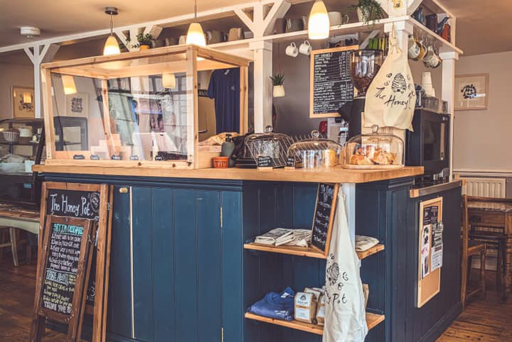 The Honey Pot navy blue counter with cakes.