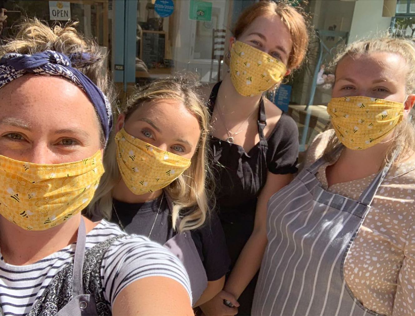 Honey staff in their bee masks