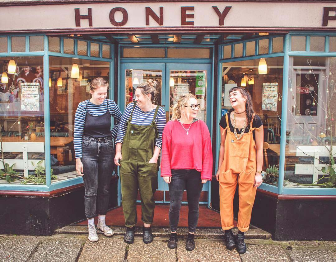 Rachel, owner of The Honey Pot, with staff members, outside the cafe front entrance.