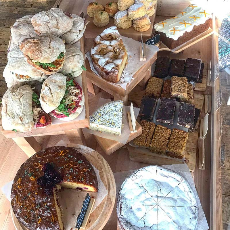 A selection of cakes, scones and sandwiches from The Honey Pot Cafe in Penzance, Cornwall.